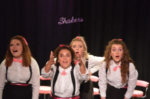 Jodie Weller (centre back) in Shakers at Sheringham Little Theatre